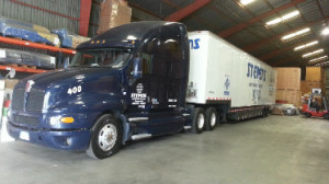 moving truck inside storage warehouse