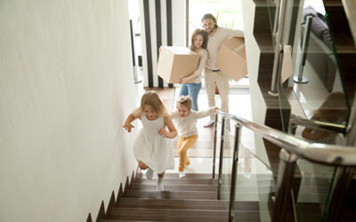 Family At New Home After Move